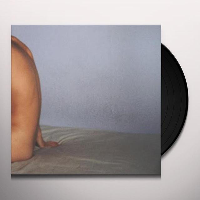 Wife WHAT'S BETWEEN Vinyl Record